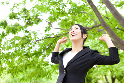 asian businesswoman relaxing in the park
